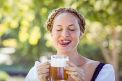 Pretty blonde drinking in the park Royalty Free Stock Images