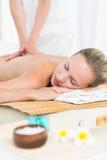 Pretty blonde enjoying a massage Stock Images