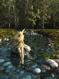 Pretty Blonde Fairy Paddling in a Forest Stream Royalty Free Stock Photography