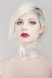 Pretty blonde fashion woman in plastic Stock Image
