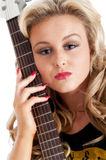 Pretty blonde female posing with guitar Royalty Free Stock Photos