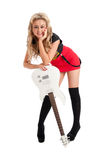 Pretty blonde female posing with guitar Royalty Free Stock Photo
