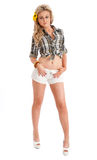 Pretty blonde female posing in shorts and shirt Stock Image