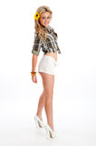 Pretty blonde female posing in shorts and shirt Stock Photo