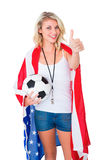 Pretty blonde football fan wearing usa flag showing thumbs up Stock Photo