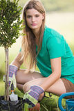 Pretty blonde gardening for her community Royalty Free Stock Photography
