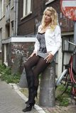Pretty blonde in ghetto. Pretty blonde standing at a ghetto street royalty free stock image