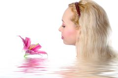 Pretty blonde girl. With pink lily on white background stock photos