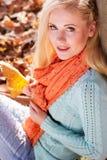 Pretty blonde girl in autumn park Stock Image