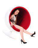 Pretty blonde girl in ball chair Royalty Free Stock Photo