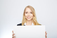 Pretty blonde girl with a blank presentation board Stock Images