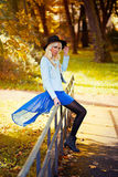 Pretty blonde girl in blue dress outdoors Stock Photos