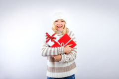 Pretty blonde girl with christmas present Stock Photos