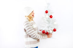 Pretty blonde girl with christmas tree Stock Photos