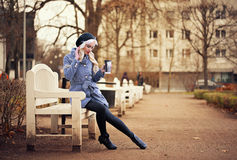 Pretty blonde girl with coffee. Beautiful blonde woman with coffee outdoors Royalty Free Stock Images