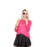 Pretty blonde girl  eating ice cream Stock Images