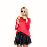 Pretty blonde girl  eating ice cream Royalty Free Stock Photography