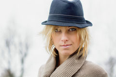 Pretty blonde girl with fedora hat. Outdoors shot stock photo