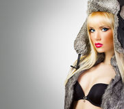 Pretty blonde girl in fur hat Royalty Free Stock Photography