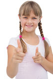 Pretty blonde girl giving thumbs up Royalty Free Stock Image