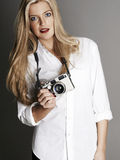 Pretty blonde girl holding camera Stock Image