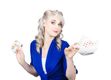 Pretty blonde girl holding a kettle and a cup Stock Photo