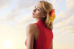 Pretty blonde girl with pink dress shows her back Royalty Free Stock Photography