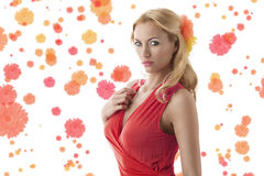 Pretty blonde girl with pink dress turned at right Stock Photography