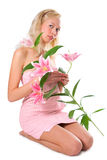 Pretty blonde girl with pink lily Stock Photos