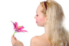 Pretty blonde girl with pink lily Royalty Free Stock Photo