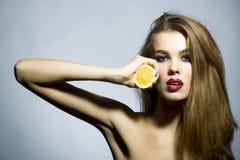 Pretty blonde girl portrait with orange Royalty Free Stock Photo