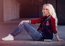 Pretty blonde girl in posing Royalty Free Stock Photos