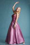Pretty blonde girl posing in dress for prom Stock Image