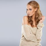 Pretty blonde girl posing while isolated Royalty Free Stock Images