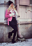 Pretty blonde girl posing outdoors Royalty Free Stock Images