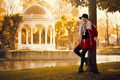 Pretty blonde girl in posing outdoors Stock Images
