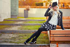 Pretty blonde girl in posing outdoors Stock Photography