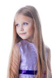 Pretty blonde girl in purple dress isolated Royalty Free Stock Images