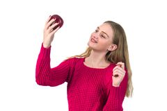 Pretty blonde girl with red apple in her hand, white background. Pretty blonde girl with red apple in her hand, white background Royalty Free Stock Image