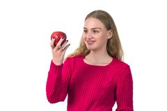 Pretty blonde girl with red apple in her hand, white background. Pretty blonde girl with red apple in her hand, white background Stock Images