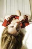 Pretty Blonde Girl In Red Christmas Outfit Hair Off Bed Stock Image