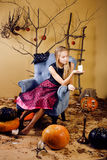 Pretty blonde girl selebrating halloween in fairy interior, lifestyle happy smiling people concept royalty free stock image