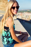 Pretty blonde girl sitting on the roof. Royalty Free Stock Photography