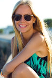 Pretty blonde girl sitting on the roof. Stock Image