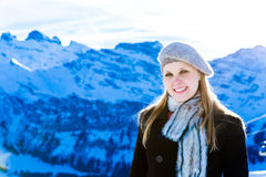 Pretty blonde girl smiling in the Alps Stock Image
