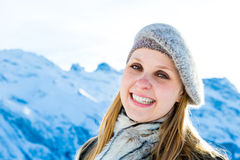 Pretty blonde girl smiling in the Alps Royalty Free Stock Photo