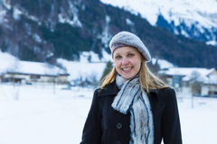 Pretty blonde girl smiling in the Alps Stock Images