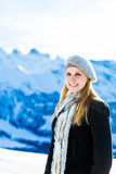 Pretty blonde girl smiling in the Alps Royalty Free Stock Photos