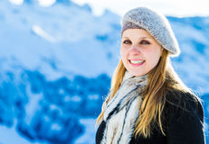 Pretty blonde girl smiling in the Alps.  Royalty Free Stock Photo