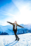 Pretty blonde girl smiling in the Alps Royalty Free Stock Image